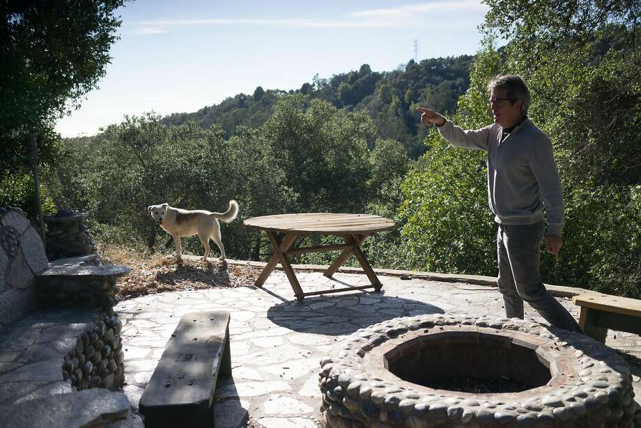 Steve Kettman shows off an area with a fire pit and pizza stove at the Wellstone Center in Soquel. The center hosts events such as writing workshops and open mikes. Photo: James Tensuan, Special To The Chronicle