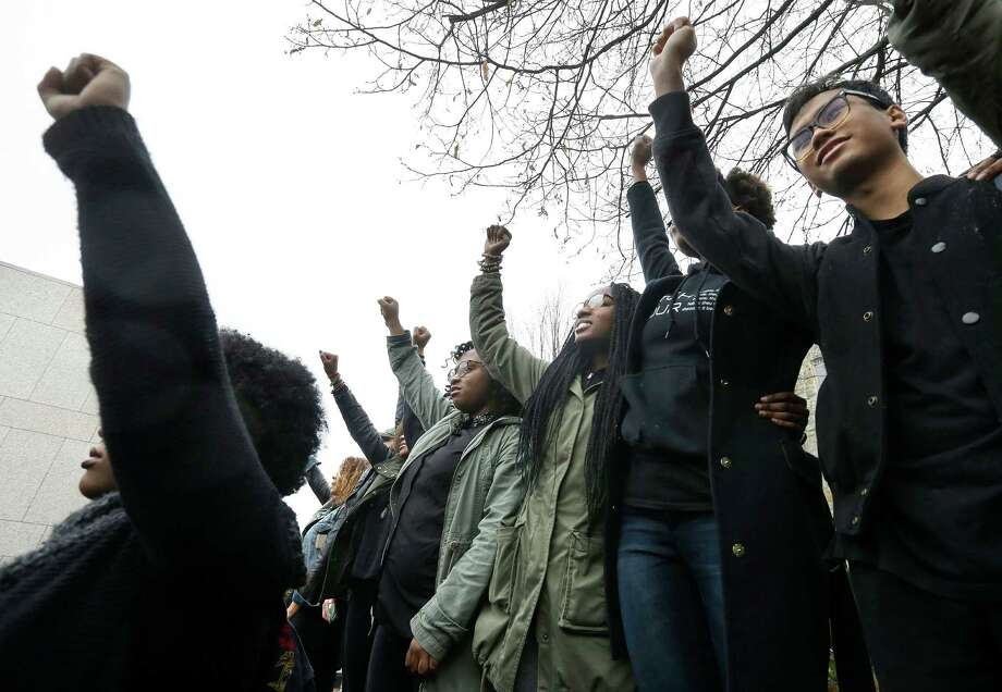 Students at Boston College raise their arms during a solidarity demonstration on the school's campus, Thursday, Nov. 12, 2015, in Newton, Mass. The protest was among numerous campus actions around the country following the racially charged strife at the University of Missouri. (AP Photo/Steven Senne) Photo: Steven Senne, STF / AP