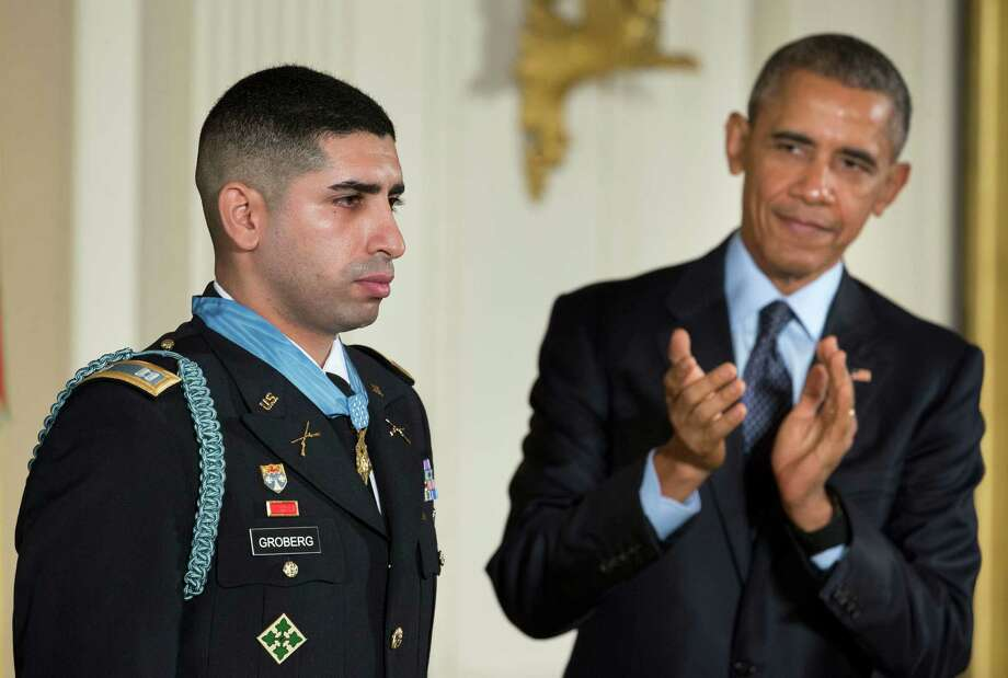 President Barack Obama applauds former Army Capt. Florent Groberg after he was bestowed the Medal of Honor on Thursday in a White House ceremony.  Photo: Pablo Martinez Monsivais, STF / AP