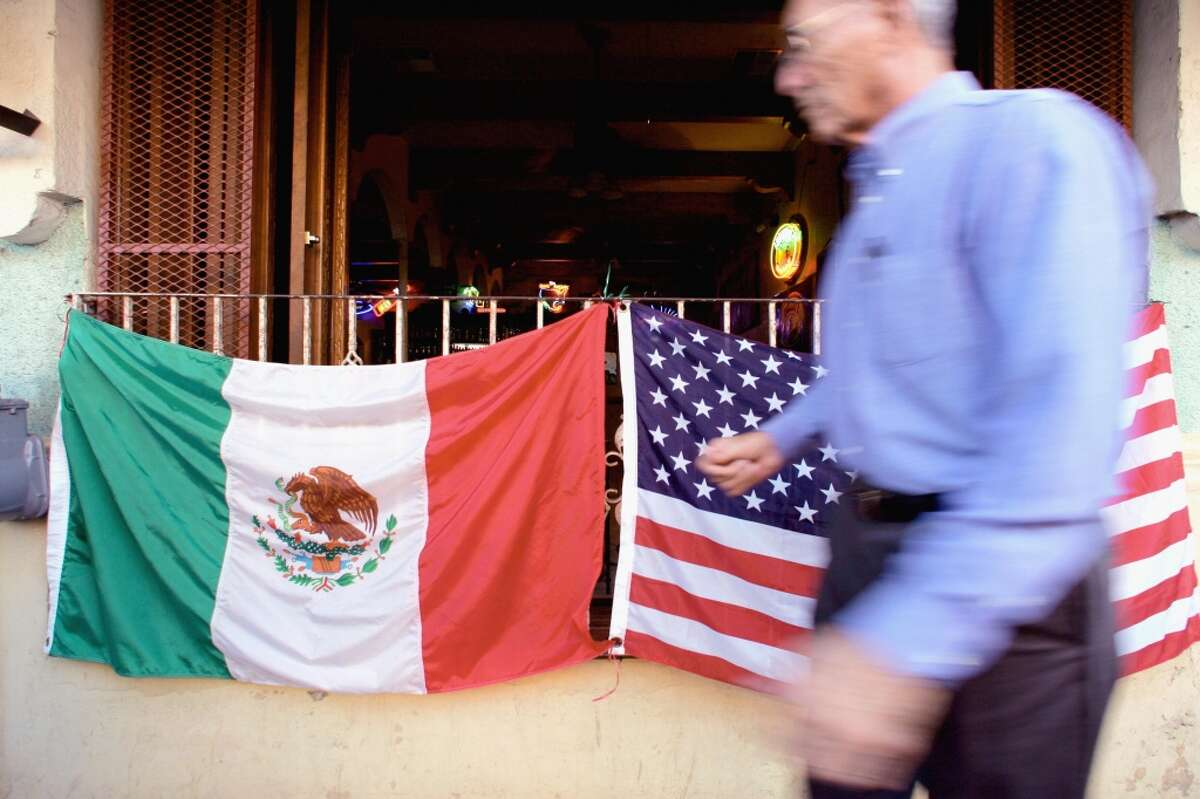 Nuevo Laredo A man walks in front of a bar with flags of Mexico and the USA in Nuevo Laredo City, Tamaulipas State, north of Mexico, 01 March 2006.