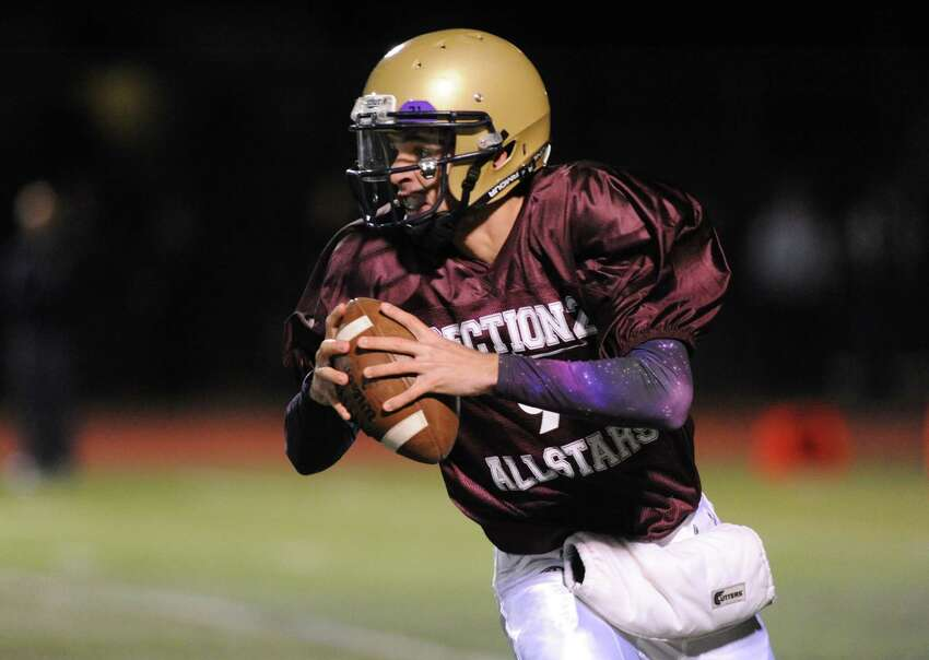 Tony Isabel of Amsterdam looks to pass during the 2014 Section 2 Exceptional Senior football game on Wednesday Nov. 12, 2014 in Clifton Park, N.Y. (Michael P. Farrell/Times Union)