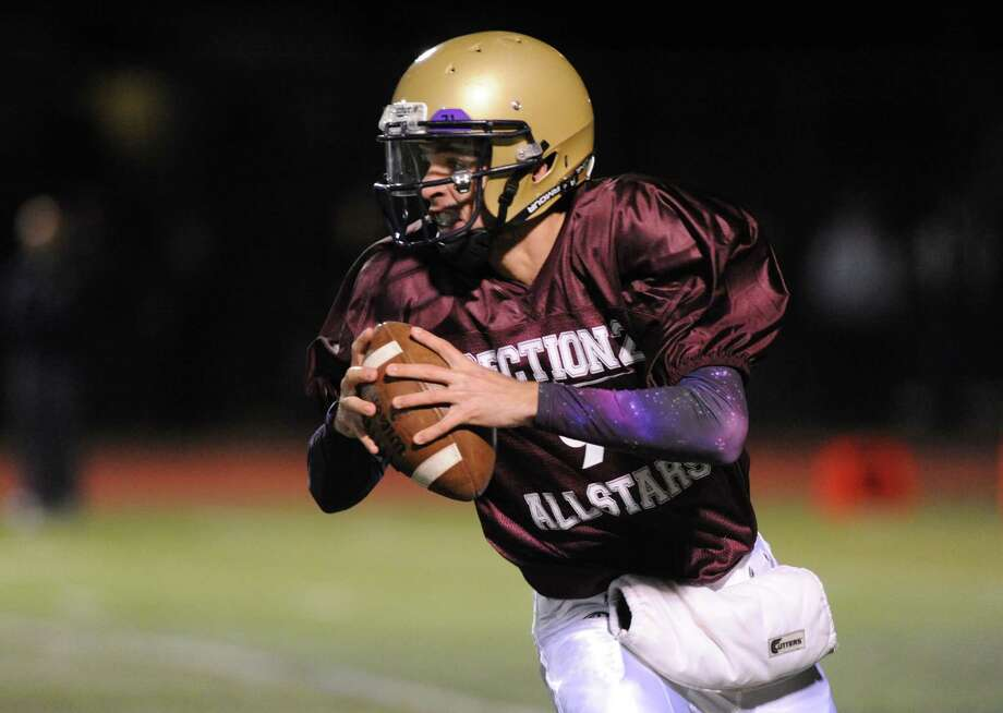 Tony Isabel of Amsterdam looks to pass during the 2014 Section 2 Exceptional Senior football game on Wednesday Nov. 12, 2014 in Clifton Park, N.Y. (Michael P. Farrell/Times Union) Photo: Michael P. Farrell / 00029456A