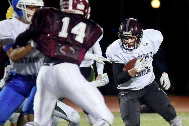 Watervliet's Mike Nadeau, right, carries the ball for the South Team against the North Team during the Exceptional Seniors football game on Thursday, Nov. 12, 2015, at Shenendehowa in Clifton Park, N.Y. (Cindy Schultz / Times Union) Photo: Cindy Schultz / 10034217A