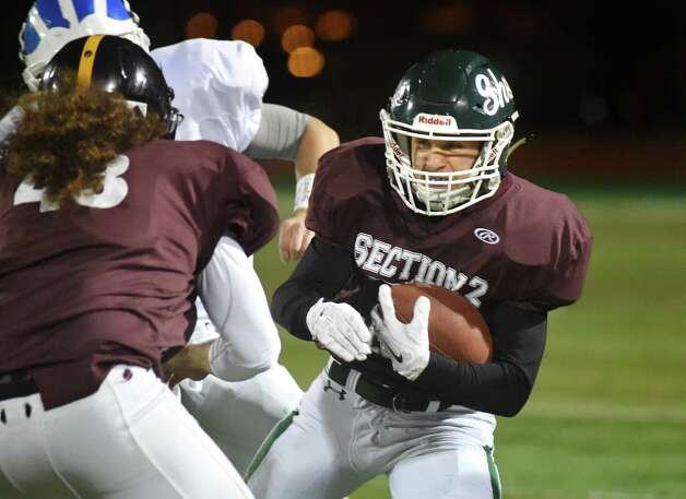 Shenendehowa's Carl Fiore, right, carries the ball for the North Team against the South Team during the Exceptional Seniors football game on Thursday, Nov. 12, 2015, at Shenendehowa in Clifton Park, N.Y. (Cindy Schultz / Times Union) Photo: Cindy Schultz / 10034217A