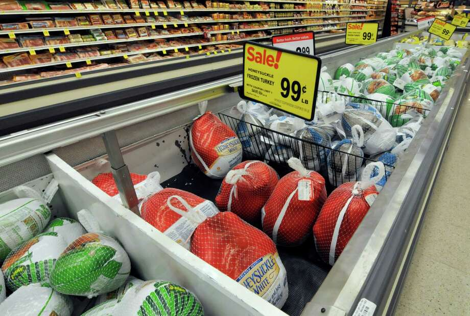 One of the most effective things grocers can do to lure holiday shoppers is offer cheap turkeys, even selling them at a loss, says a former retail food price economist with the U.S. Department of Agriculture. With all the other items, the average cost of a Thanksgiving dinner for 10 people has hovered around $49 since 2011.  Photo: Jim Mone, STF / AP