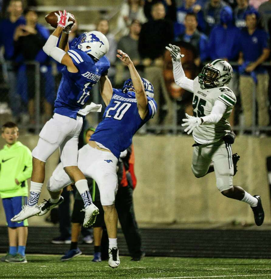 Friendswood's Nick Dehoyos (12) leaps to intercept a pass intended for Hightower's Andre Lewis during the fourth quarter of a Class 6A Division II Bi-District playoff football game at Hall Stadium on Thursday, Nov. 12, 2015, in Missouri City. Friendswood beat Hightower 27-24 to advance in the playoffs. Photo: Brett Coomer, Houston Chronicle / © 2015 Houston Chronicle