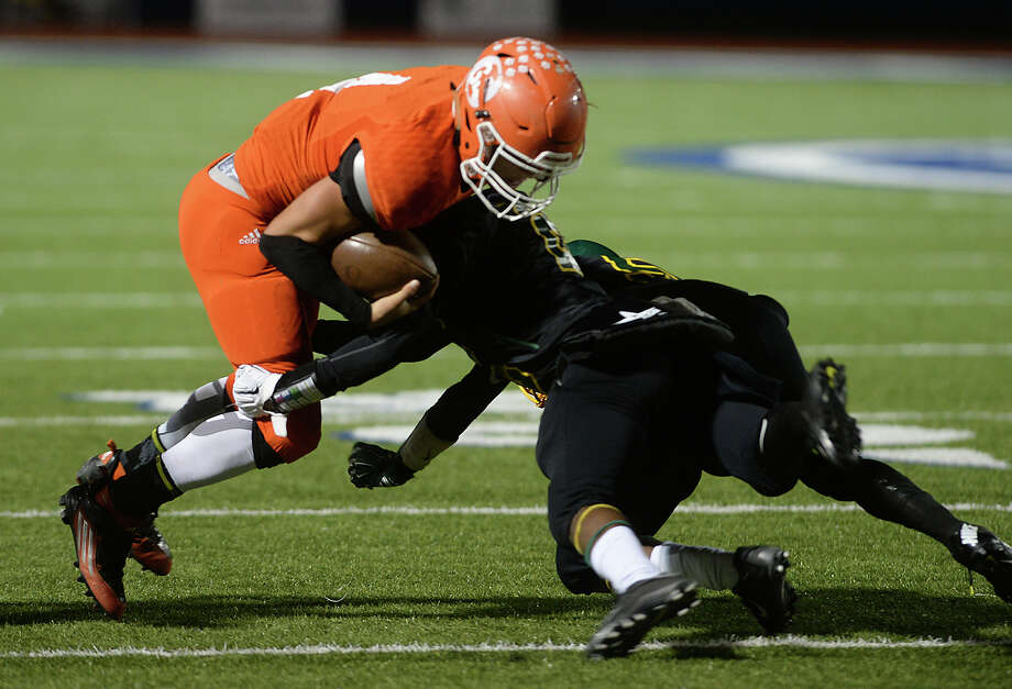 Orangefield's  Matthew Watkins is tackled by Worthing's defense as he carries the ball during their playoff game Thursday night at Barbers Hill High School. Photo taken Thursday, November 12, 2015 Kim Brent/The Enterprise Photo: Kim Brent / Beaumont Enterprise