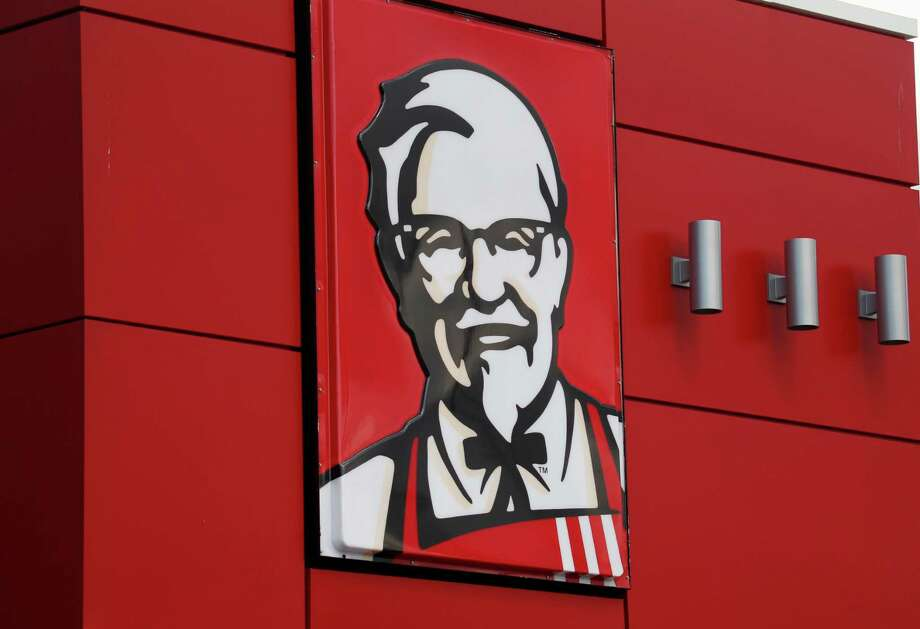 FILE - In this Tuesday, Oct. 9, 2012, file photo, a close-up of a sign with a picture of Colonel Sanders is shown on the wall of a combination Kentucky Fried Chicken, Taco Bell in Doral, Fla. KFC said it will start delivering its buckets of fried chicken to customers in Los Angeles and San Francisco, beginning Thursday, Nov. 12, 2015. It's the first time the chicken chain has delivered in the United States. (AP Photo/Wilfredo Lee, File) Photo: Wilfredo Lee, STF / AP