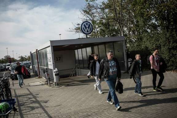 Workers leave after a morning shift last month at the Volkswagen factory in Wolfsburg, Germany. VW announced an amnesty program for informants that will expire at the end of the month. The offer excludes top management.
