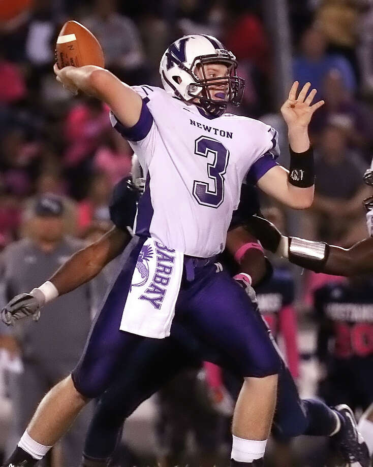 Brock Barbay, 3,  passes the ball during the game between the WO-S Mustangs and the Newton Eagles at Dan R. Hooks Stadium in Orange, Friday night October 2nd, 2015 - Photo provided by Kyle Ezell