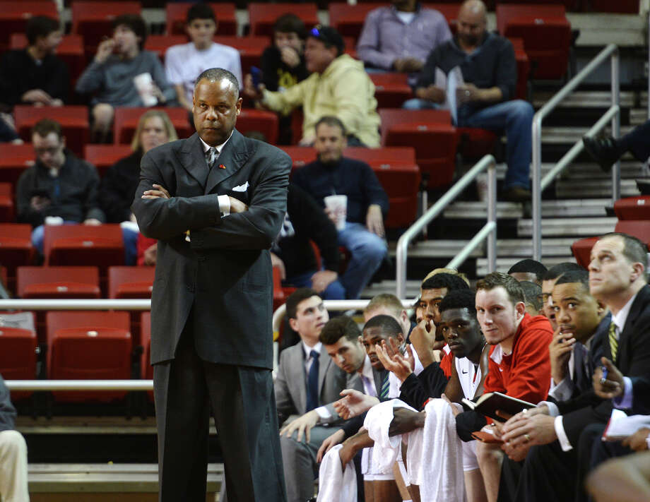 Coach Tic Price and benched Cardinals keep an eye on the action during Saturday night's game against the Colonels. The Lamar Cardinals hosted the Nicholls Colonels at the Montagne Center on Saturday. Photo taken Saturday 1/3/15 Jake Daniels/The Enterprise Photo: Jake Daniels / ©2014 The Beaumont Enterprise/Jake Daniels