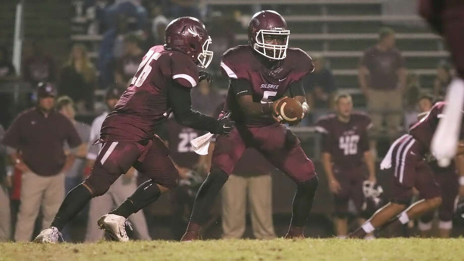 Dontre Thomas, 5,  looks to hand the ball off to Adonis Thomas, 26, during the game between the Silsbee Tigers and the Jasper Bulldogs at Tiger Stadium in Silsbee, Friday night November 6th, 2015 - Photo provided by Kyle Ezell