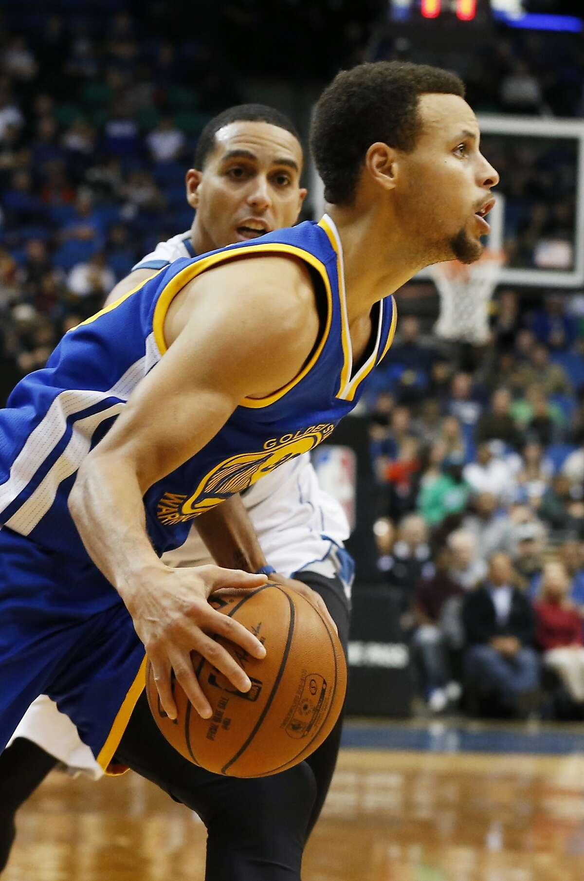 Golden State Warriors' Stephen Curry drives past Minnesota Timberwolves' Kevin Martin during the second half of an NBA basketball game, Thursday, Nov. 12, 2015, in Minneapolis. The Warriors won 129-116. Curry scored 46 points. (AP Photo/Jim Mone)