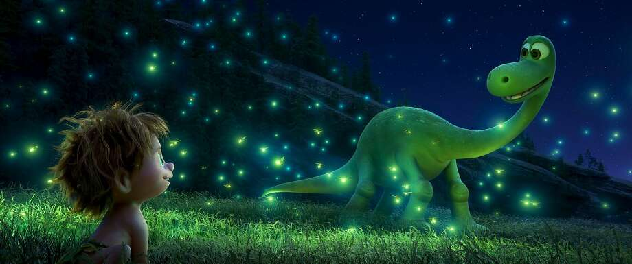 """""""The Good Dinosaur"""" asks the question: What if the asteroid that killed the dinosaurs had missed the planet? Dinosaurs are in charge in a reversal on the boy-and-his-dog story. Photo: Disney Pixar"""