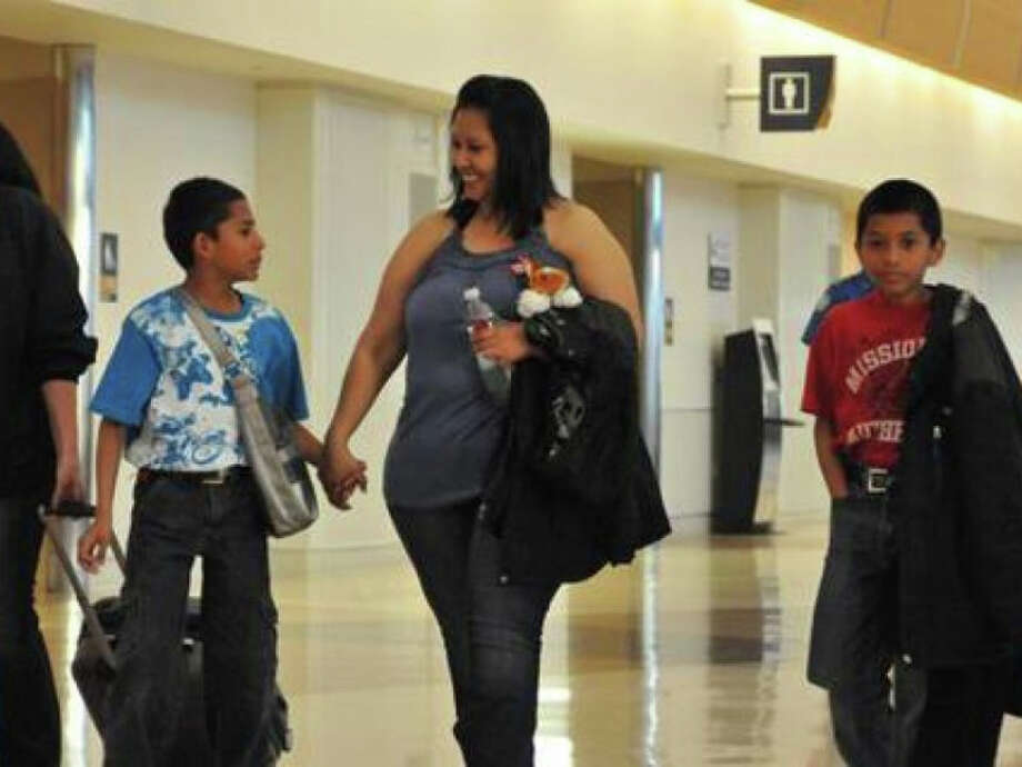 Sarina Hernandez walks with her sons shortly after were returned to the United States by law enforcement agents in March 2013. Photo: FBI Photo