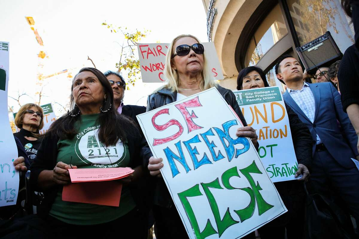 Teacher Ana Fisher (second from left) and Assembly member David Chiu (right) came out to protest the budget cuts that are being made at CCSF at UN Plaza in San Francisco, California on Thursday, November 12, 2015.