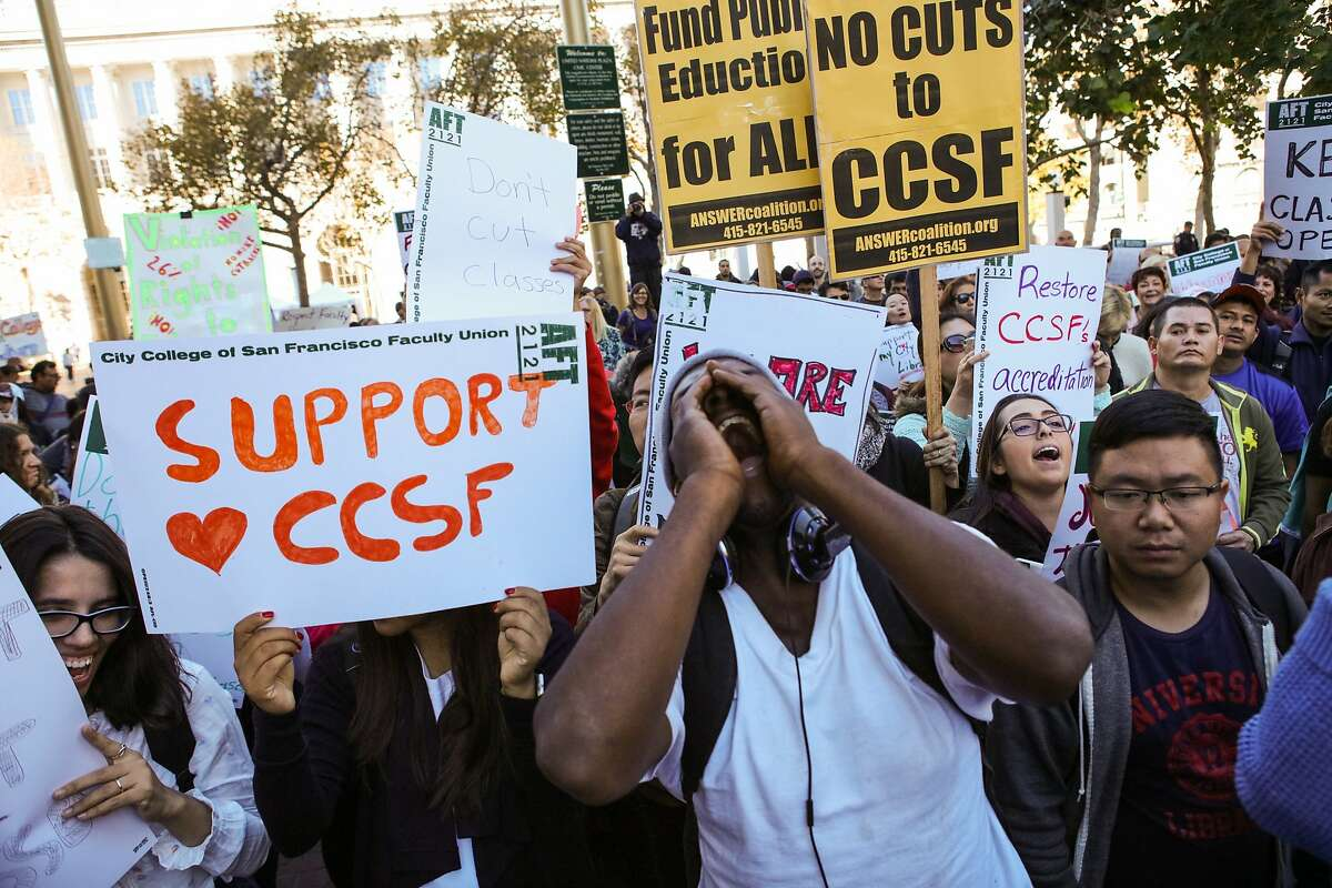 Joe Drake Jr. (center) chants slogans during a rally to oppose CCSF's intentions to shrink classes and lay off more then a quarter of the faculty, at UN Plaza in San Francisco, California on Thursday, November 12, 2015.