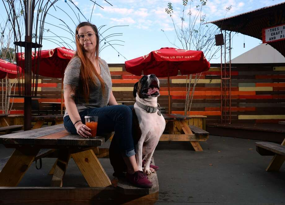 Chelsy Broussard and Darla a 4-year-old boxer at Madison's. Madison's patio is open to friendly canine companions.  Guiseppe Barranco/The Enterprise Photo: Guiseppe Barranco, Guiseppe Barranco/The Enterprise