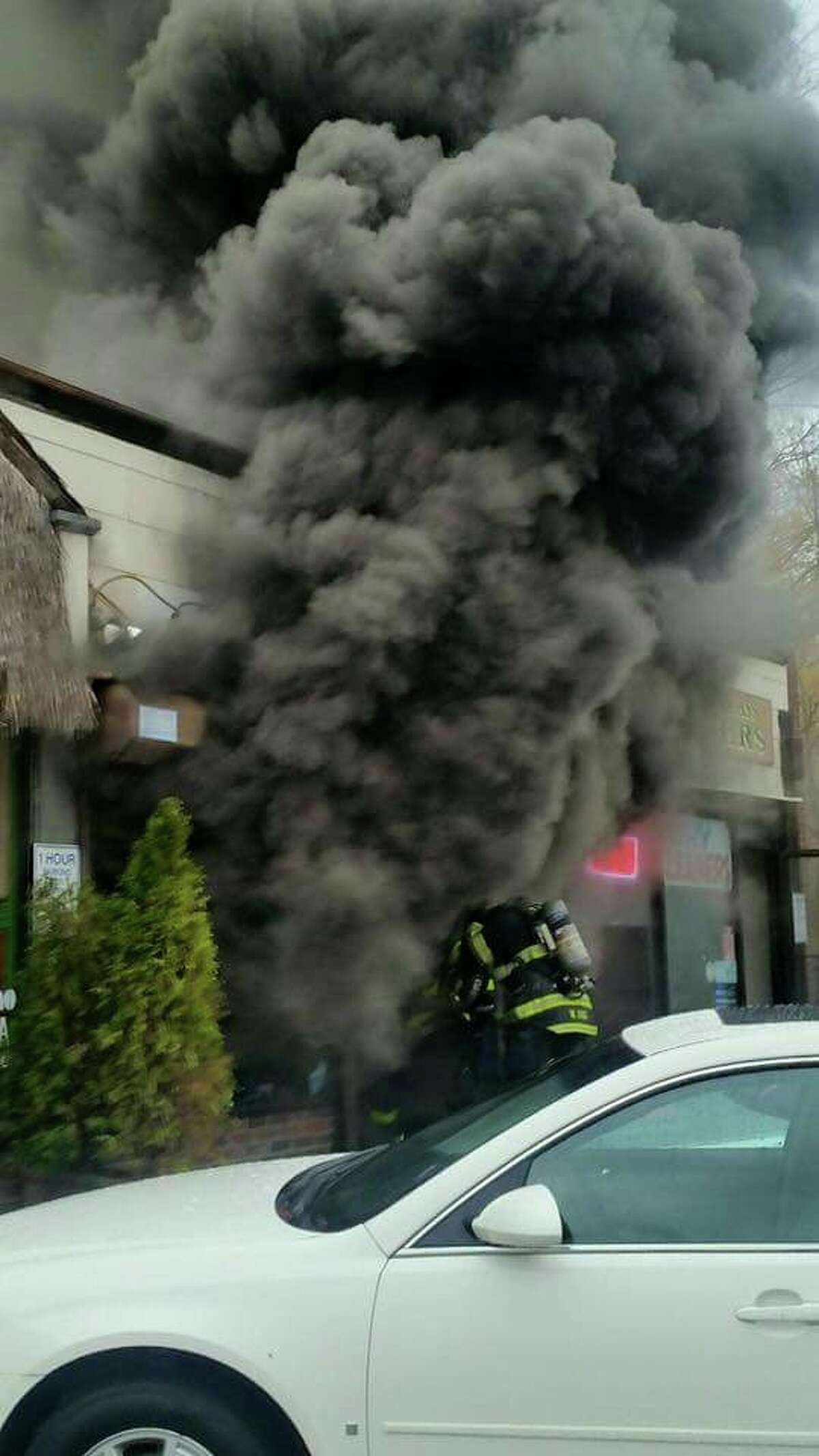 A fire on Thursday, Nov. 12, 2015 heavily damaged an East Norwalk shopping center. one-story shopping center 8 Rogers Square containing seven businesses According to Deputy Chief Chris King that fire broke out around 2:30 p.m. at a one-story shopping center 8 Rogers Square containing seven businesses including a variety store, dry cleaners, restaurant and florist.