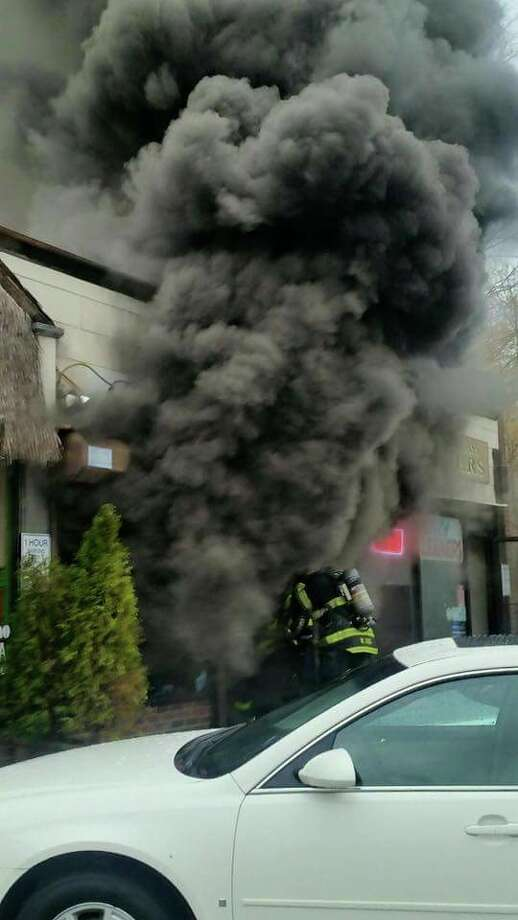 A fire on Thursday, Nov. 12, 2015 heavily damaged an East Norwalk shopping center. one-story shopping center 8 Rogers Square containing seven businesses According to Deputy Chief Chris King that fire broke out around 2:30 p.m. at a one-story shopping center 8 Rogers Square containing seven businesses including a variety store, dry cleaners, restaurant and florist. Photo: Norwalk Fire Department