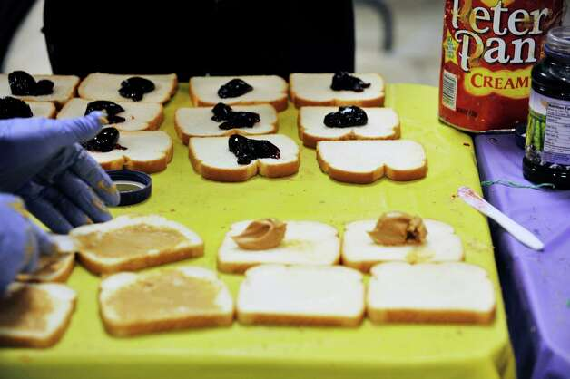 College of Saint Rose students, staff and faculty volunteer their time to make peanut butter and jelly sandwiches during the PB & Jams event, sponsored by the The Saint Rose Student Association on Thursday, Nov. 12, 2015, in Albany, N.Y.  The goal of the event was to make 3,500 sandwiches which will be donated to seven area shelters.  This is the fifth year of the event, which has grown in size and in the number of sandwiches made every year.  Organizers estimated that between 300 and 400 members of the Saint Rose community will have taken part in the one-day event by the time it is finished.  Supplies for the event were donated by Freihofer's, Cap Com FCU, Shop Rite, Price Chopper, Walmart, Sam's Club, the college's Office of Student Affairs and the School of Education.  (Paul Buckowski / Times Union) Photo: PAUL BUCKOWSKI / 00034173A