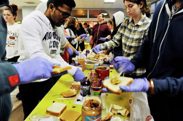 College of Saint Rose students, staff and faculty volunteer their time to make peanut butter and jelly sandwiches during the PB & Jams event, sponsored by the The Saint Rose Student Association on Thursday, Nov. 12, 2015, in Albany, N.Y.  (Paul Buckowski / Times Union) Photo: PAUL BUCKOWSKI / 00034173A