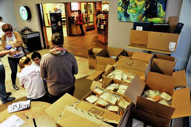 College of Saint Rose students box up peanut butter and jelly sandwiches during the PB & Jams event, sponsored by the Saint Rose Student Association on Thursday, Nov. 12, 2015, in Albany, N.Y.  The goal of the event was to make 3,500 sandwiches which will be donated to seven area shelters.  (Paul Buckowski / Times Union) Photo: PAUL BUCKOWSKI / 00034173A
