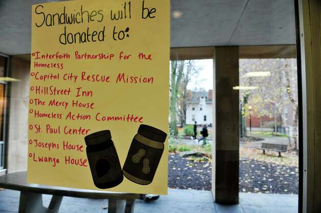 A list of shelters that will benefit from the College of Saint Rose Student Association's PB & Jams event, is seen on a window at the college on Thursday, Nov. 12, 2015, in Albany, N.Y.  (Paul Buckowski / Times Union) Photo: PAUL BUCKOWSKI / 00034173A
