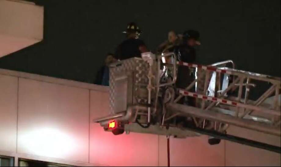 Houston Fire Department crews were called to George Bush Intercontinental Airport to remove smoke in Terminal C, caused by smoldering construction materials outside, Nov. 13, 2015. Photo: Christian, Carol, Via Metro Video