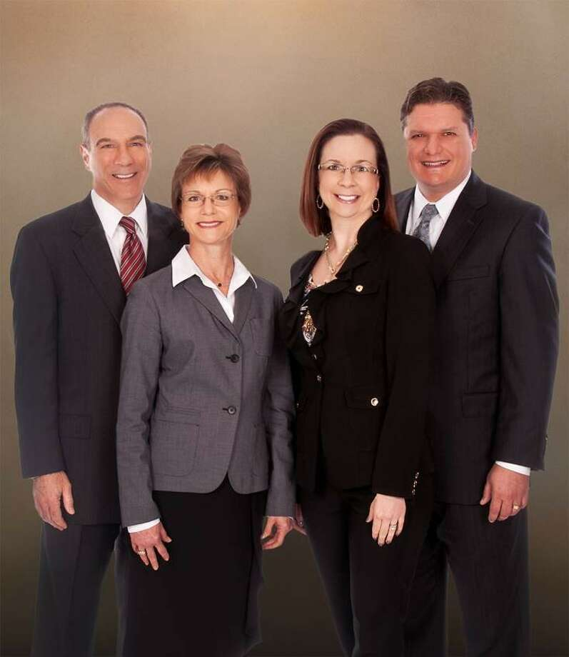 The Ellis-Nabors Team includes, from left, Mark Ellis, Catherine Ellis, Amy Nabors and Clint Nabors. The team will continue to work with buyers and sellers in Cypress and surrounding areas.