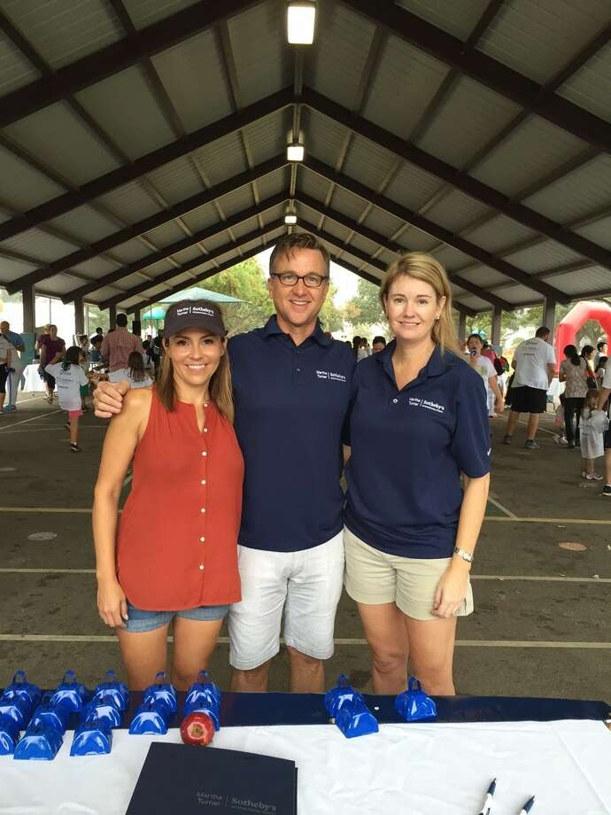 MTSIR agents Miranda Stokes, Jay Monroe and Liz Daniel supported the River Oaks Elementary Fun Run with cowbells and encouragement.