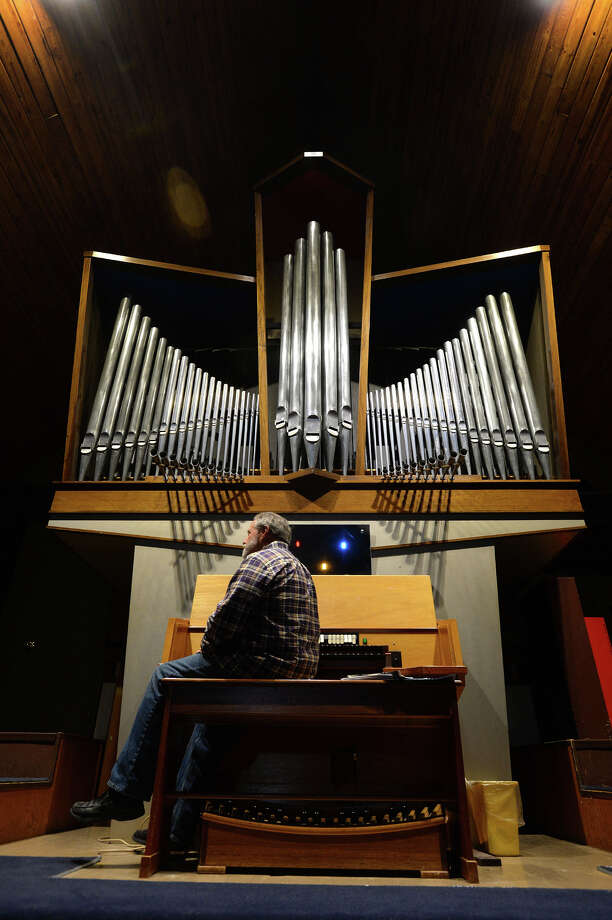 Chris Richter sits at a North German Baroque pipe organ at Bethlehem Lutheran Church in Beaumont on Thursday. Recently closing its doors, the church is auctioning the organ with a possible buyer in New York City. 