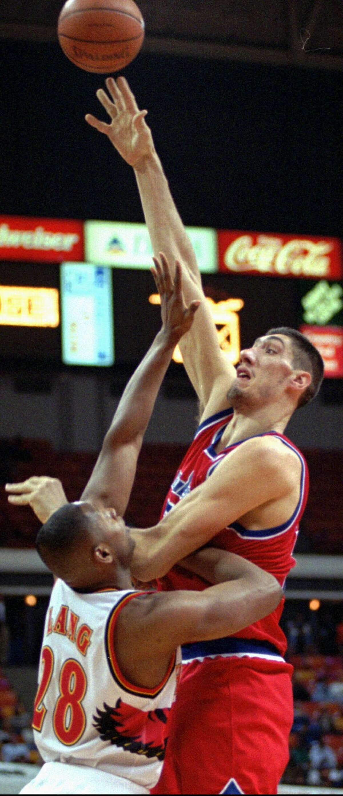 TALLEST PLAYERS IN NBA HISTORY Gheorghe Muresan,7-7 Although both Muresan and Bol were listed at 7-7, Muresan measured slightly taller than Bol. He played for the Washington Bullets (1993-97) and the New Jersey Nets (1998-2000).