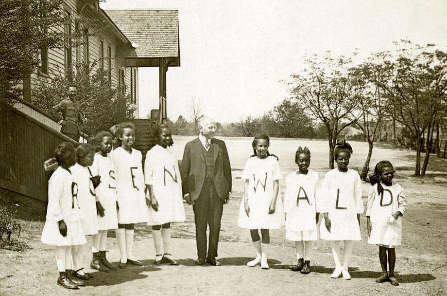 Julius Rosenwald is flanked by students from one of the schools he helped fund in African-American communities in the South. Photo: HANDOUT, STR / THE WASHINGTON POST