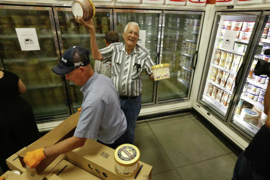 Fans of Blue Bell Ice Cream were happy to show off the containers that they were able to buy — the first in the area to purchase Blue Bell products in Brenham. The company will begin phase three of its return to the market on Dec. 14, bringing its ice cream products back to San Antonio several months after a deadly listeria outbreak sparked a recall. Photo: Steve Gonzales /Associated Press / Houston Chronicle