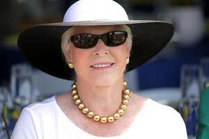 In this June 22, 2013 photo, Lois Colley attends a match at the Mashomack Polo Club in Pine Plains, N.Y. Lois Colley, 83, a socialite known to mingle among New York's most powerful families, and the wife of a millionaire McDonald's franchisee, was found dead in the couple's North Salem, N.Y., hilltop estate Monday, Nov. 9.