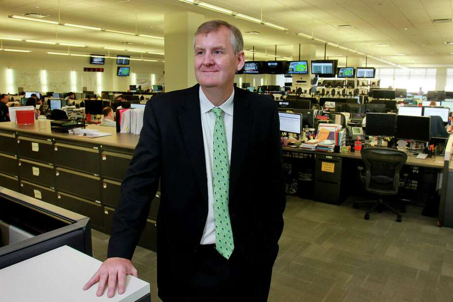 Calpine CEO Thad Hill visits the generating company's  trading floor in Houston (Chronicle photo) Photo: Gary Fountain, Freelance / Copyright 2015 by Gary Fountain