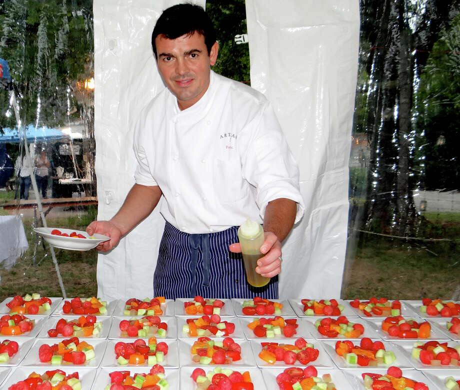 Chef Frederic Kieffer of Artisan Restaurant preparing late-summer tomato salads at Wakeman Town Farm's Harvest Fest dinner. Photo: Mike Lauterborn / For Hearst Connecticut Media / Westport News