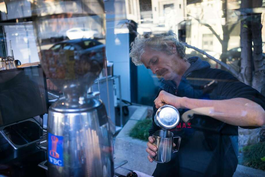 Richard Hess pours coffee for a customer in downtown San Jose, Calif. on Thursday, Nov. 12, 2015. Kartma is run by people transitioning out of homelessness. Photo: James Tensuan, Special To The Chronicle