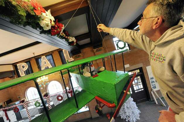 Volunteer Ralph Poulopoulos works at putting up decorations in the Washington Park lake house in preparation for the 19th Annual Price Chopper Capital Holiday Lights in the Park on Friday Nov.13, 2015 in Albany, N.Y. (Michael P. Farrell/Times Union) Photo: Michael P. Farrell / 00034229A