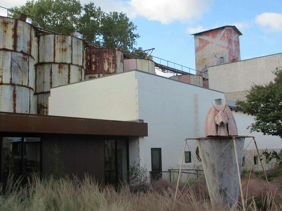 The old weathered silos that were once part of a dilapidated feed mill in Johnson City have been converted to bays that house science and art exhibits at the Hill Country Science Mill that opened in February. Photo: Terry Scott Bertling / San Antonio Express-News