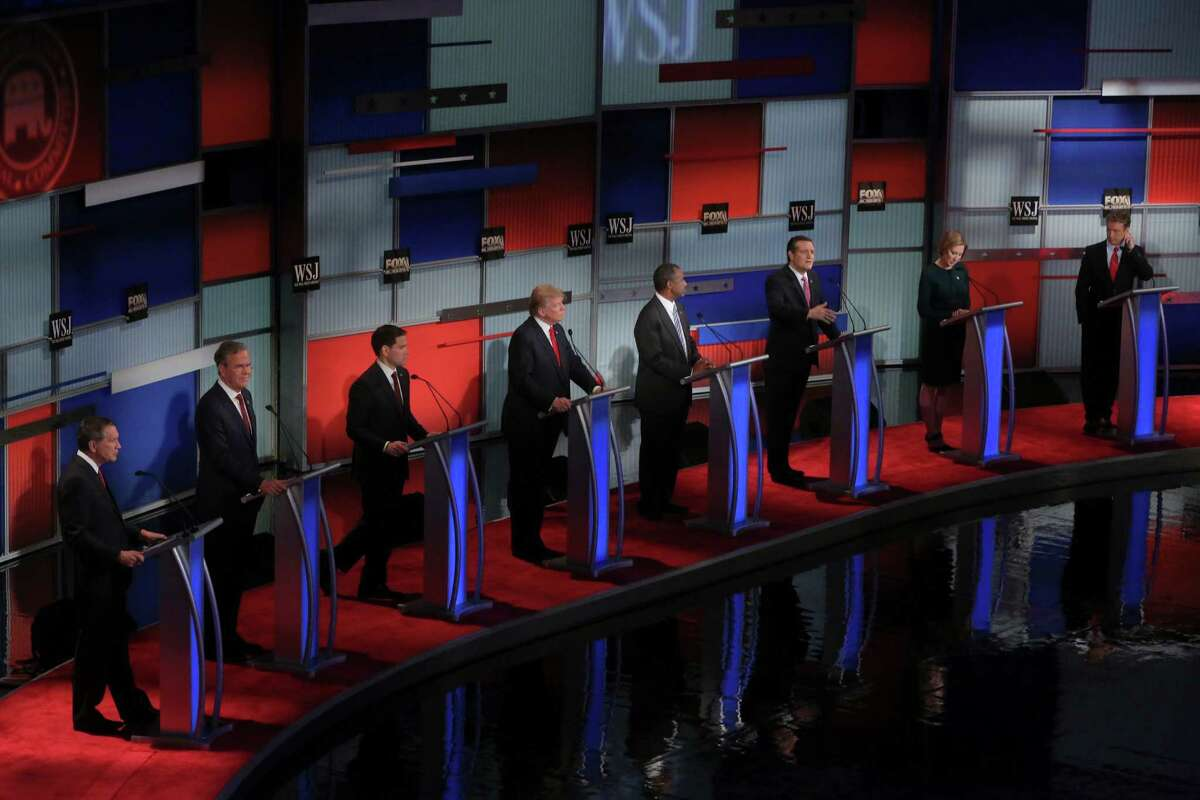 Candidates look on as Sen. Ted Cruz (R-Texas), third from right, speaks during the Republican debate, at the Milwaukee Theatre in Milwaukee, Nov. 10, 2015. From left: Gov. John Kasich, Jeb Bush, Sen. Marco Rubio, Donald Trump, Ben Carson, Cruz, Carly Fiorina and Sen. Rand Paul. (Michael Appleton/The New York Times) ORG XMIT: XNYT176