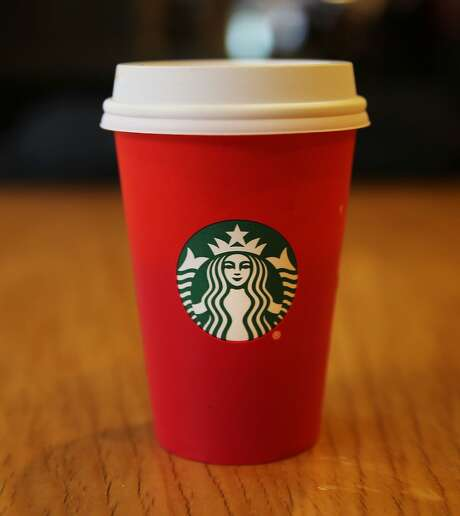 NEW YORK, NY - NOVEMBER 12: A new holiday Starbucks cup is viewed on November 12, 2015 in New York City. The coffee giant has come under criticism by some for leaving any Christmas or traditional holiday signage off of the red cup. While Starbucks has said there is no cultural or political message to the design, critics claim that the company doesn't want to offend non-Christians or those who don't celebrate Christmas.  (Photo by Spencer Platt/Getty Images) Photo: Spencer Platt, Getty Images