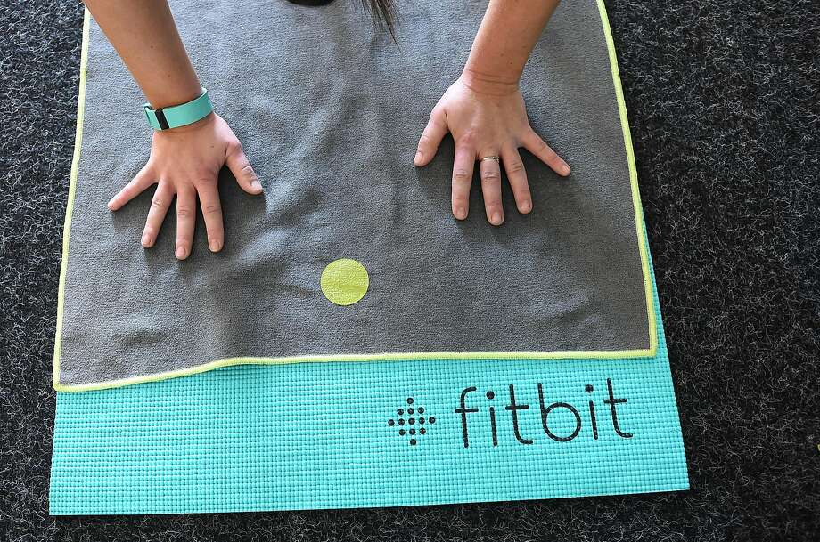 Yoga classes are offered at Fitbit in San Francisco on November 12, 2015.  Fitbit