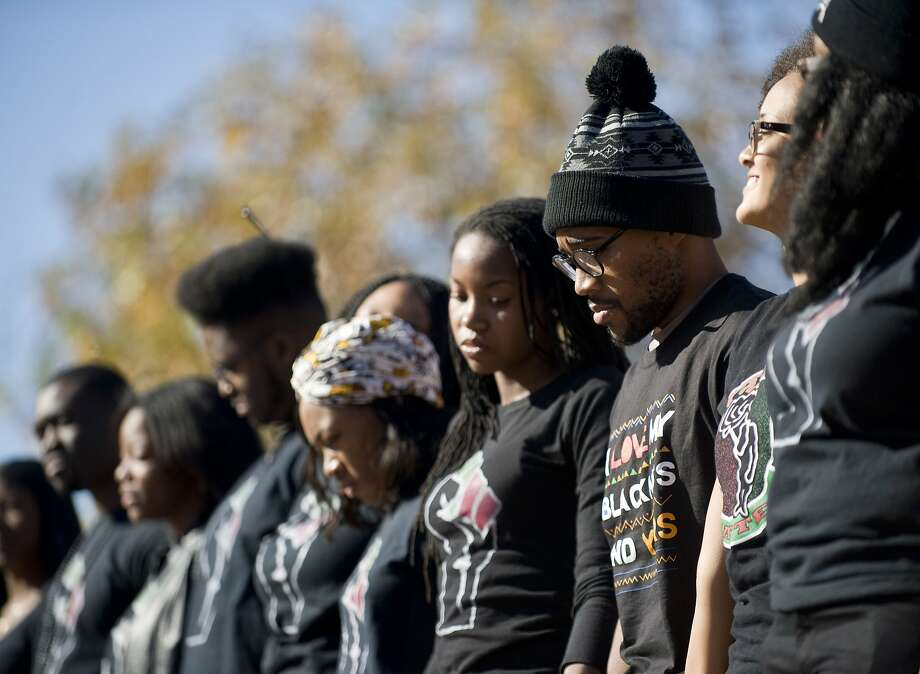 Graduate student Jonathan Butler, second from right, stands with supporters of the student protest group Concerned Student 1950 during a news conference following the announcement of the resignation of University of Missouri President Timothy Wolfe, on campus in Columbia, Mo., Nov. 9, 2015. Wolfe announced that he was stepping down after a wave of student outcry, including an ultimatum from dozens of black football players that they would not play if he did not resign. (Daniel Brenner/The New York Times) Photo: Daniel Brenner, New York Times