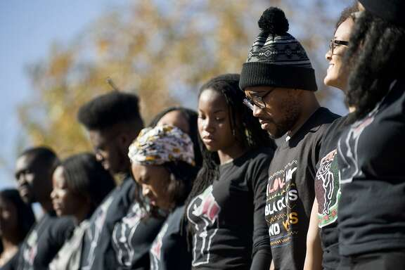 Graduate student Jonathan Butler, second from right, stands with supporters of the student protest group Concerned Student 1950 during a news conference following the announcement of the resignation of University of Missouri President Timothy Wolfe, on campus in Columbia, Mo., Nov. 9, 2015. Wolfe announced that he was stepping down after a wave of student outcry, including an ultimatum from dozens of black football players that they would not play if he did not resign. (Daniel Brenner/The New York Times)
