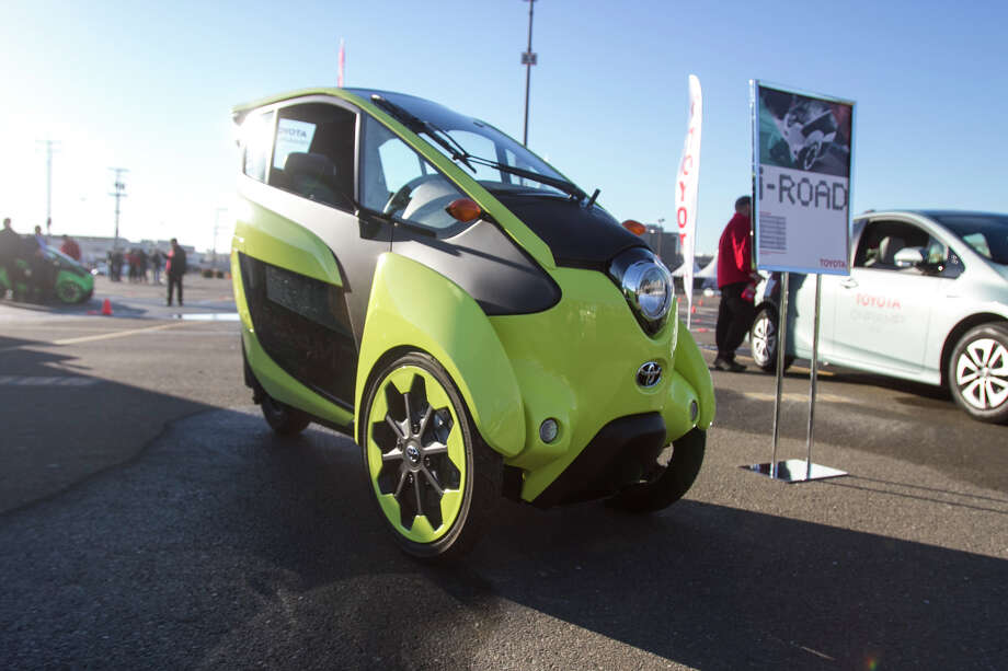 "Toyota offered test-drives of the i-Road concept — a three-wheeled electric vehicle — during their ""Onramp"" event in San Francisco on Friday, November 13, 2014. Photo: Michael Raspino, Chris Preovolos/Hearst Newspapers / (c) 2015"