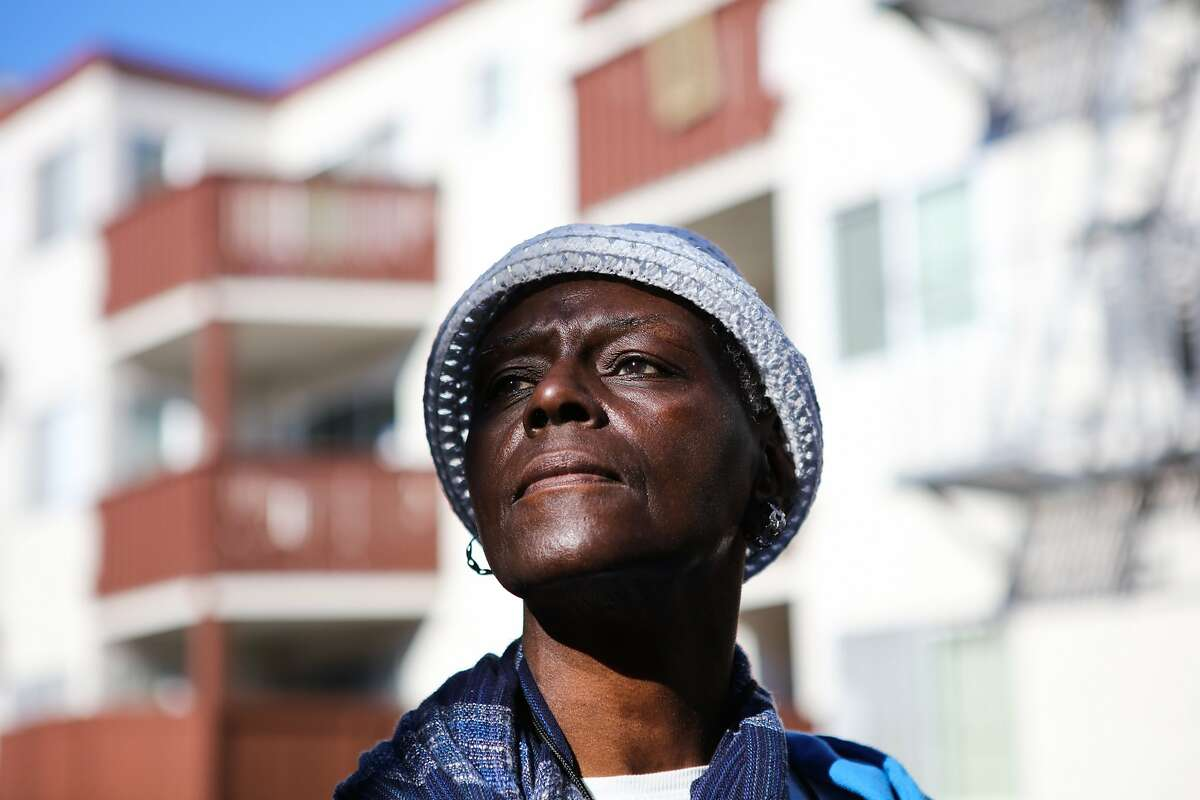 Johnnie Mae High looks out onto the street in the courtyard of her apartment complex in San Francisco, California on Friday, November 13, 2015. She has applied for below market rate housing six times since 2009 but has been denied each time.
