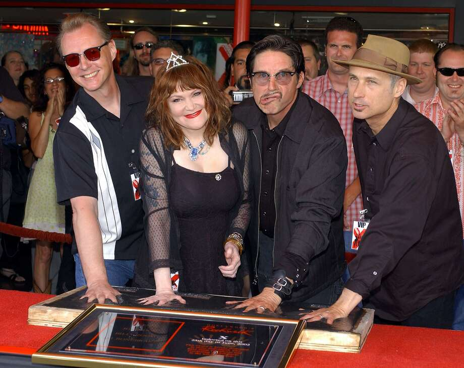 Billy Zoom (left), Exene Cervenka and John Doe attend X's induction into the Hollywood Rockwalk. Photo: Vince Bucci, Getty Images