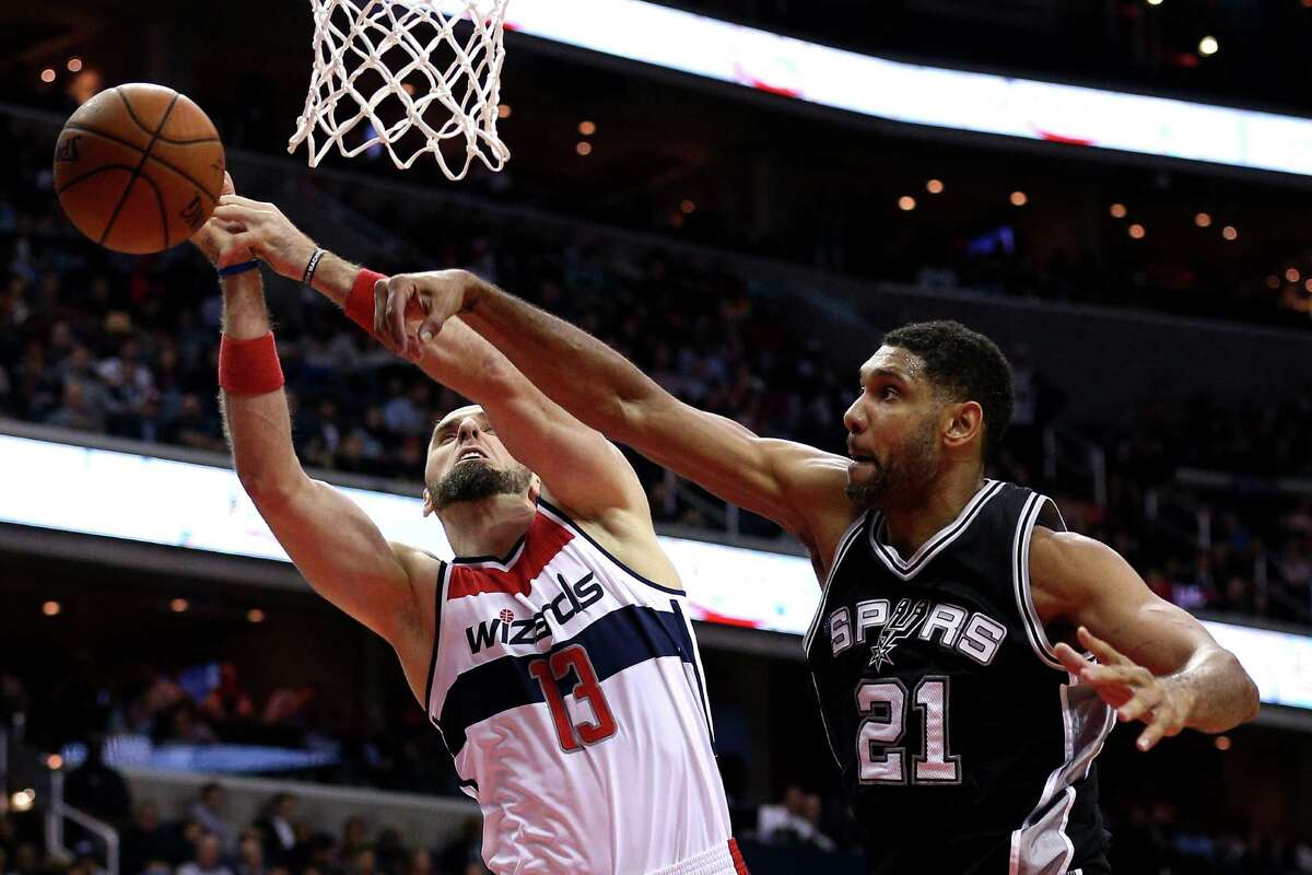Marcin Gortat of the Wizards has a shot blocked by Tim Duncan of the San Antonio Spurs during the first half at Verizon Center on Nov. 4, 2015 in Washington.